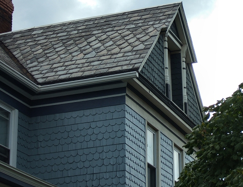 Note all the different textures you find in an original Victorian house. Note the pattern made by the various roof slates and siding shingles. The builders always seem to do interesting things with the window trim found in the gables.