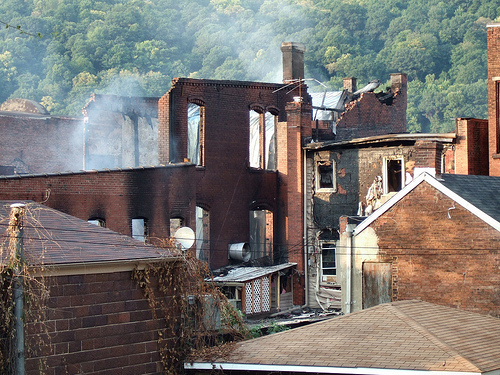 Rear view of two buildings damaged by the fire taken from Chess St. looking north.