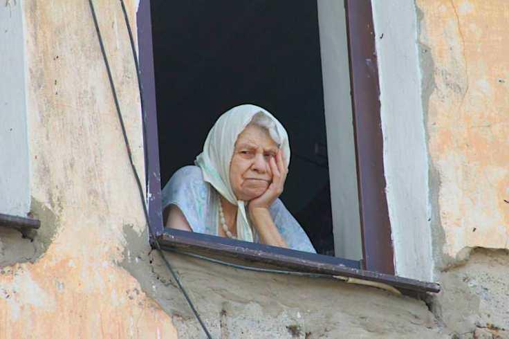 woman at window watching