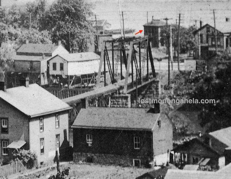 Ellsworth Secondary railroad bridge pointing to the mystery building. (Detail of postcard postmarked 1909)